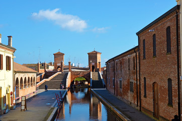 """Small Italian town Comacchio also known as """"The Little Venice"""", Emilia Romagna region, province of Ferrara, Italy: Colored houses in traditional architectural style"""