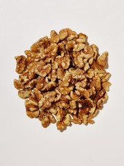 Pile of shelled walnuts on white background