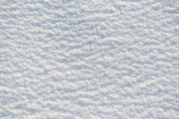 snow for texture or background at sunny day, bright light with shadows, flat lay, top view, clean and nobody