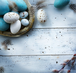 Easter background with Easter eggs on white table