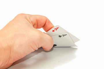 Hand with two cards aces. on a white background.