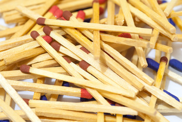 match sticks spread on white paper abstract concept