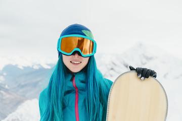 Snowboarder girl in winter.