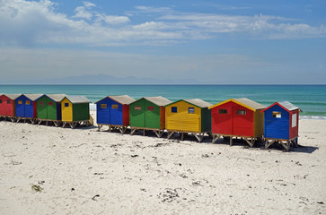 View of the brightly colored Victorian beach cabin houses on the Muizenberg Beach in Cape Town
