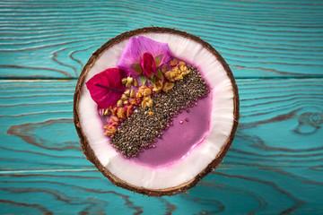 Acai bowl smoothie inside coconut chia granola