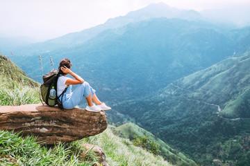 Tourist woman enjoy with beautiful view on mountains and valley in Ella, Sri Lanka, Little Adam Peak