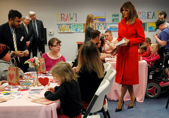 First lady Melania Trump hands out Valentine's Day cards to children during her visit at the Children's Inn at the National Institutes of Health in Bethesda