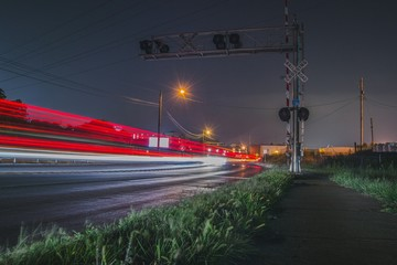 Red Light Trails On Road At Night