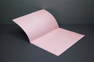 High Angle View Of Pink Paper Against Gray Wall