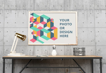 Horizontal Framed Poster in an Office Mockup 1
