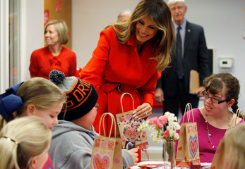 First lady Melania Trump exchanges Valentine's Day cards with children during her visit at the Children's Inn at the National Institutes of Health in Bethesda
