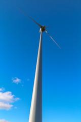 A wind turbine seen from below