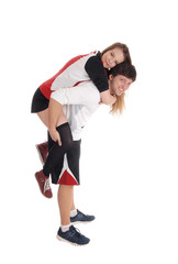 Young couple in exercise outfit do piggyback