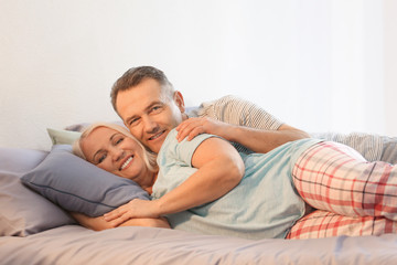 Senior couple on bed together