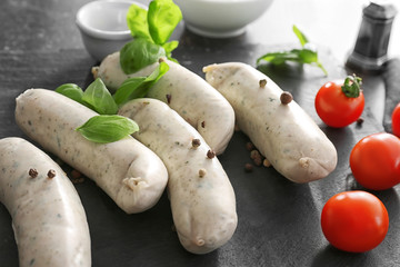 Delicious white sausages on slate plate