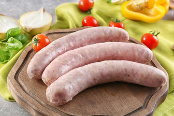 Delicious sausages on wooden board