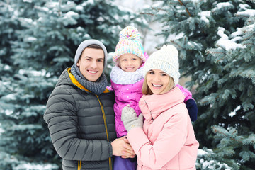 Portrait of happy family in winter park