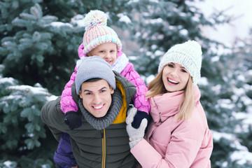 Portrait of happy family in winter park