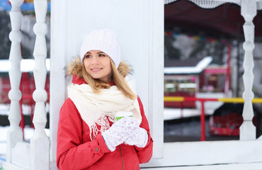Portrait of happy smiling woman outdoors on winter day