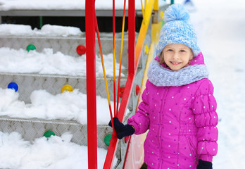 Portrait of cute little girl outdoors on winter day