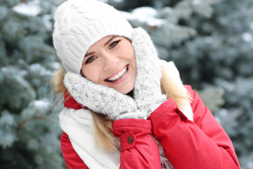 Portrait of happy smiling woman in winter park