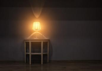 Stylish table lamp in dark room