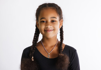 portrait of beautiful dark-skinned girls on a white background. the child smiles.