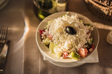 So called shopska salad, traditional addition to a meal in any restaurant, seasonal salad