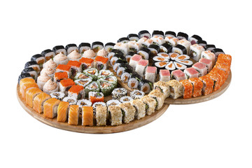 Sushi set on a wooden board, isolated.