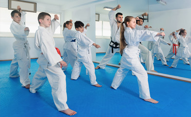 Teenagers practicing a new moves with master