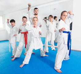 Teenagers happy to attend karate class