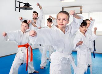 Foto op Aluminium Vechtsport Children trying martial moves in karate class