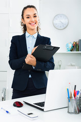 Portrait of  businesswoman with clip pad in  office