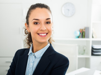Successful laughing woman working in office