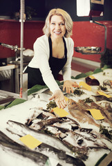 Woman working in fish store