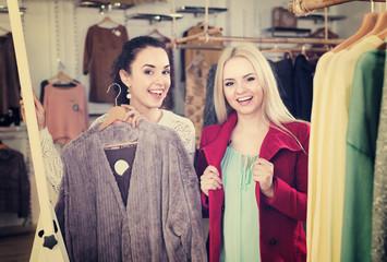 Girlfriends choosing warm jacket