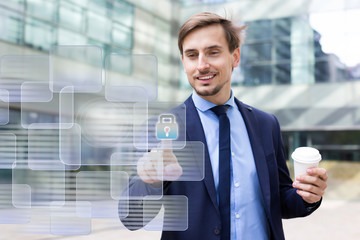 Man pressing icons on virtual touchscreen