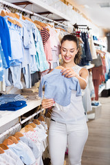 Woman shopping blue baby apparel