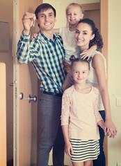family standing at doorway