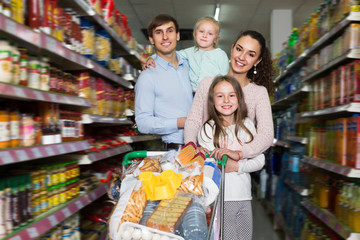 Young family with two daughters shopping