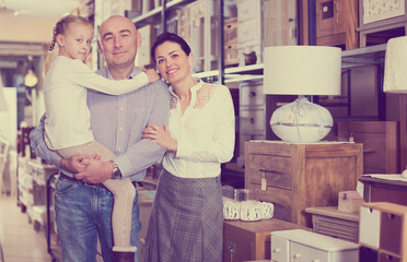family in furniture store