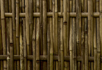 rustic yellow bamboo fence