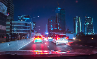 Fast moving traffic light trails at night in Bangkok, Blurred background