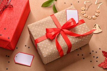 Beautiful gift boxes with decor on color background