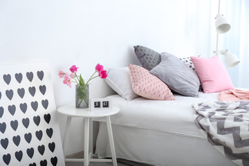 Comfortable double bed in modern stylish interior