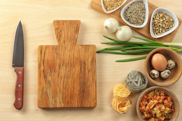 Wooden board and products on light background. Cooking master classes