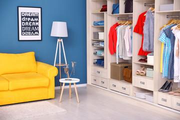 Dressing room interior with big wardrobe