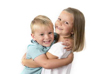 7 years old adorable blond happy girl posing with her little 3 years old brother smiling cheerful isolated on white background