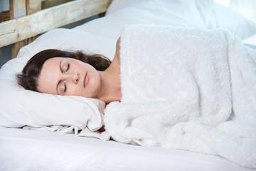 Beautiful girl. White warm blanket. Sleep