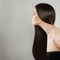 Elegant Dark Hair Girl Portrait. Pretty Woman on Grey Background
